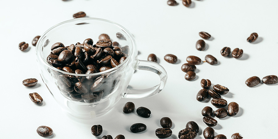 Coffee beans in clear cup