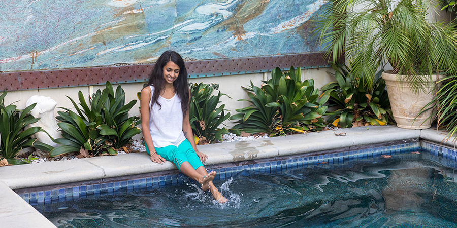 Banyan friend Anjali dips her feet in a pool during the height of pitta season (summer)