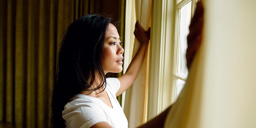 Banyan friend Jen gazes out of a window.