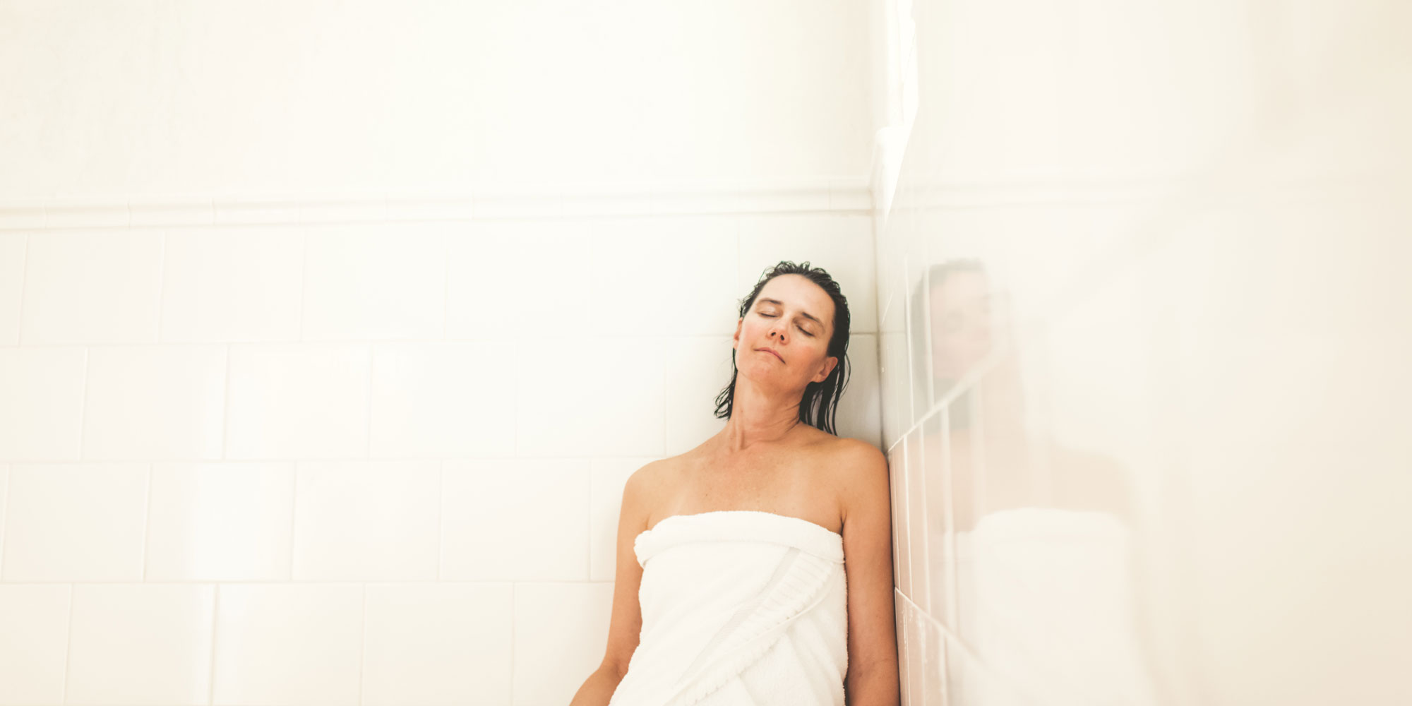 woman relaxing in spa setting