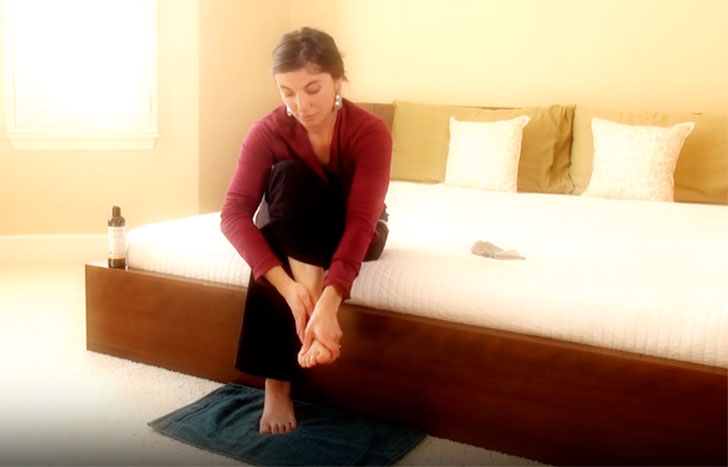woman massaging her feet