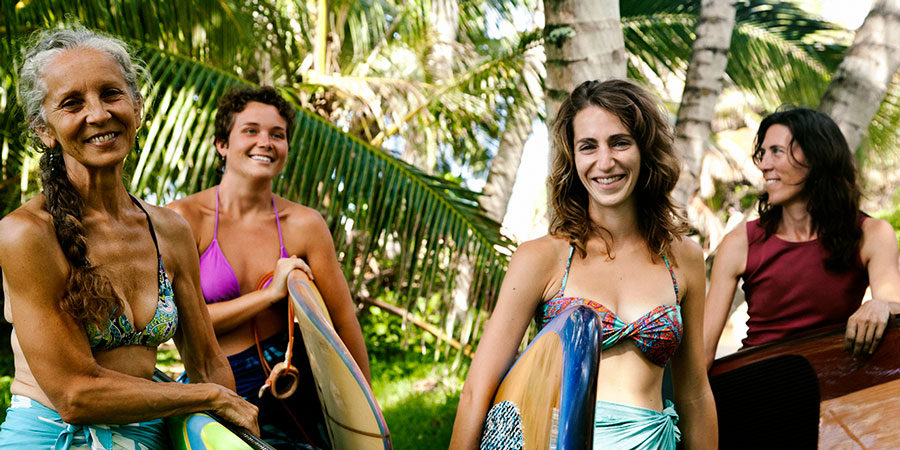 group of women ready for surfing