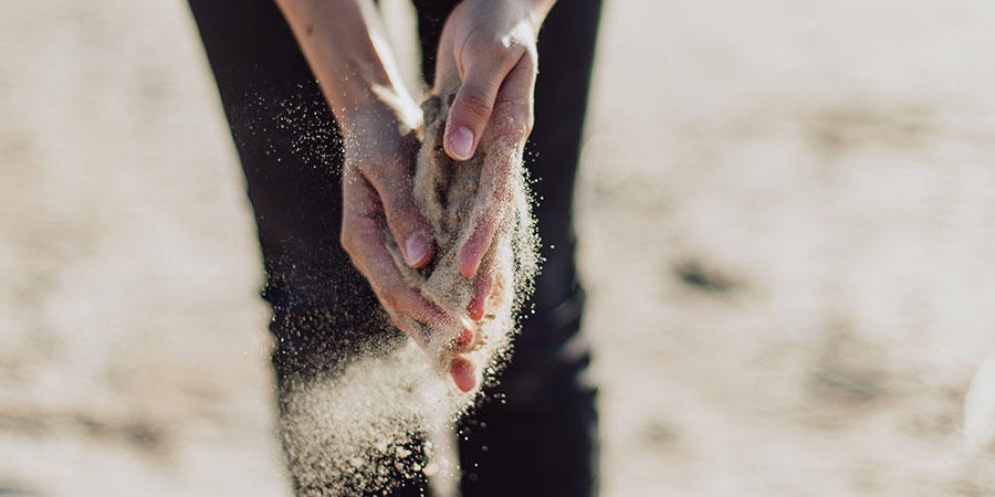 hands holding sand