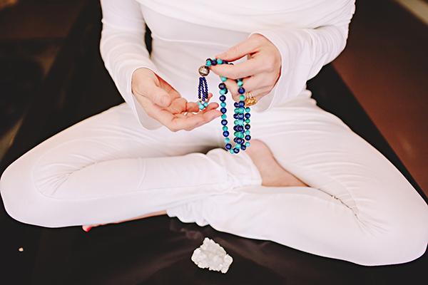 holding mala beads