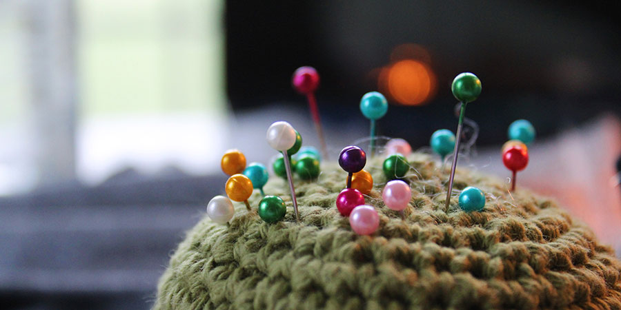 Pin cushion with multicolored pins