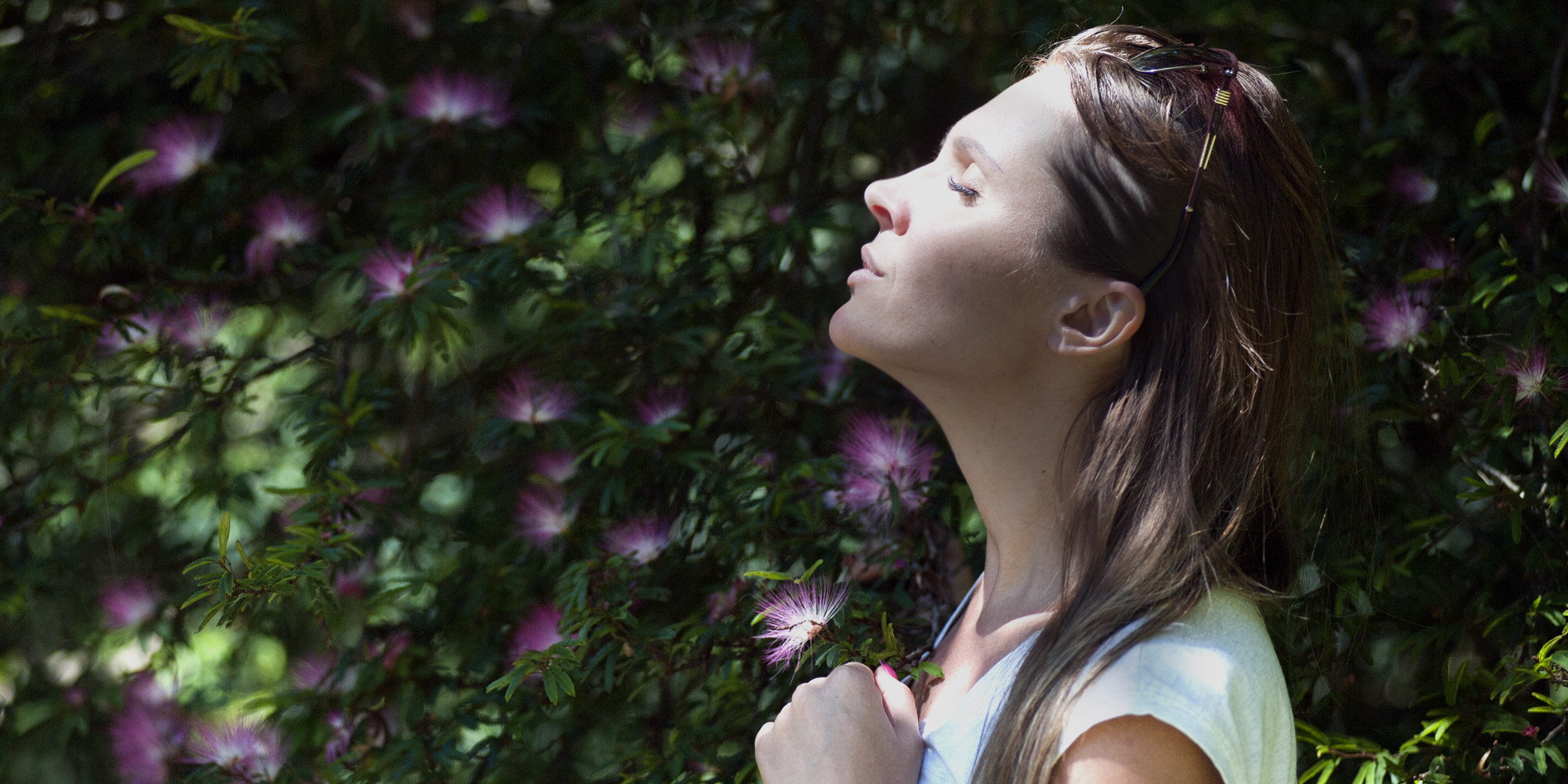 woman closing eyes in nature