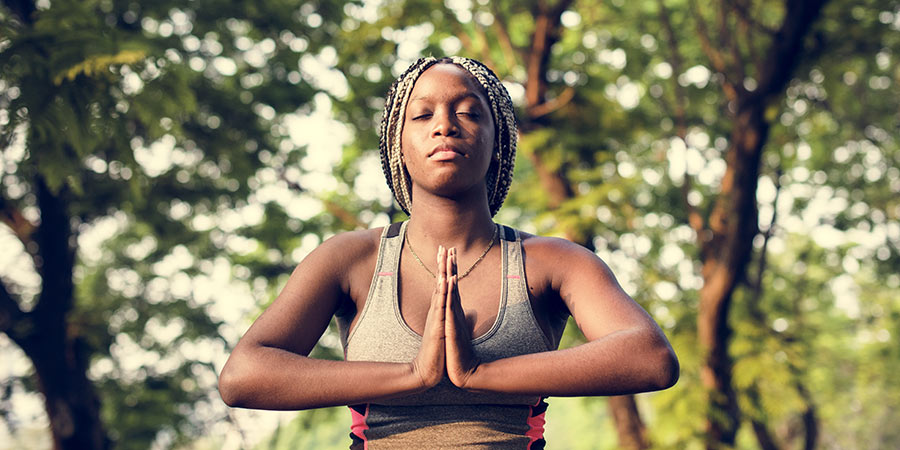 Woman meditates in park