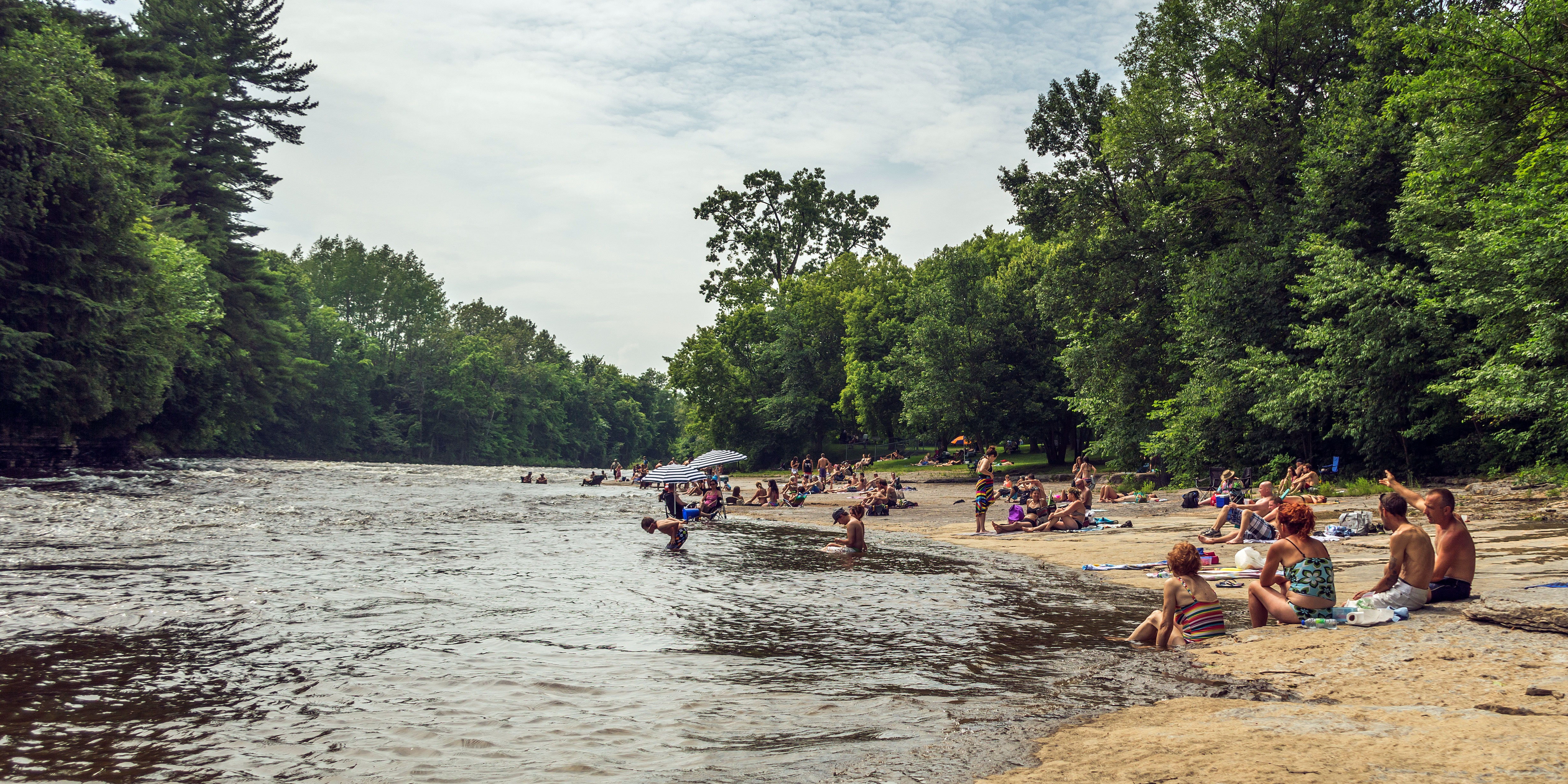 swimmers along the river