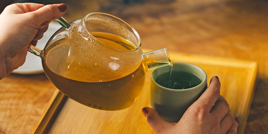 Tulsi Fields Tea being poured into a cup
