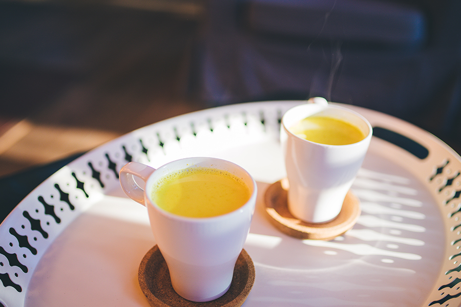2 steaming cups of turmeric milk mix