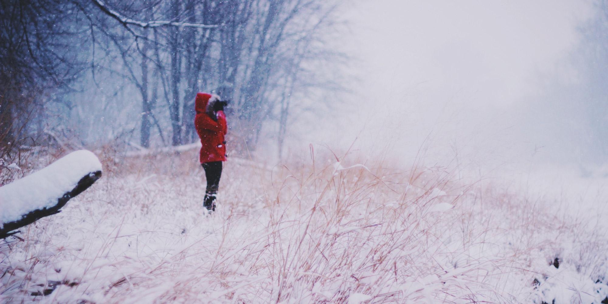woman standing in winter field